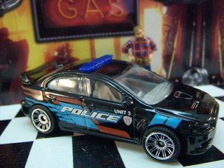 12 MATCHBOX MITSUBISHI LANCER EVOLUTION X POLICE CAR MINT LOOSE 164