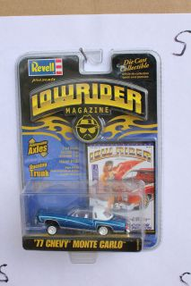 64 1977 CHEVROLET MONTE CARLO BLUE WITH WHITE TOP LOWRIDER MAGAZINE