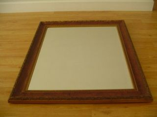 LARGE FRAMED WALL MIRROR. 27.75 W X 33.5 H. BROWN WOODEN FRAME