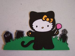 Cricut Hello Kitty in Black Cat Costume in the Graveyard