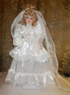 Porcelain Bride doll 17 tall detailed costume veil train bouquet eye