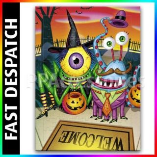 Trick or Treat Monsters on Welcome Mat Jigsaw Puzzle 3 Sizes Available