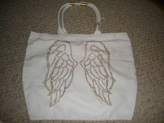 Victorias Secret white canvas with gold studded angel wings design