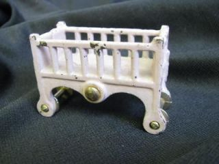 cast iron kilgore crib on wheels original paint
