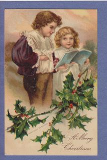 911 christmas holly boy girl reading book clapsaddle time left