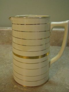 sadler 7 milk pitcher cream and lots of gold england