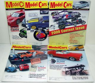 this auction includes a lot of 5 2008 2009 model cars magazines that