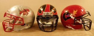 Three Former Arena Football League Team Mini Helmets