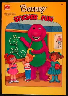 up for auction is a n barney sticker book published by golden in 1993