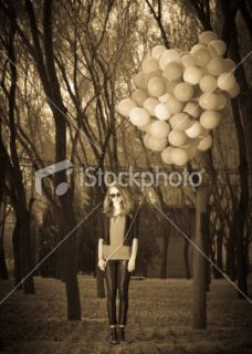 stock photo 14515209 girl holding balloons