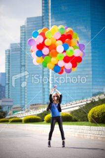 stock photo 12742403 woman holding many balloons