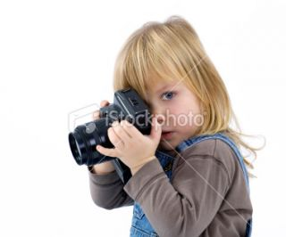 young girl, child, trying to shoots photos Royalty Free Stock Photo