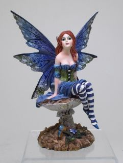 Item AMY BROWN BLUE WINGED FAIRY SITTING IN GARDEN FIGURINE STATUE