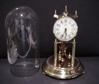 VINTAGE ANTIQUE BRASS GERMAN ANNIVERSARY CLOCK IN GLASS DOME KEY WIND