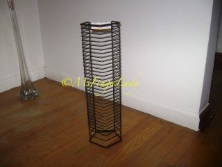 this cd wall tower rack holds total 35 standard single cd jewel cases