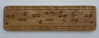 Cribbage board with carved deer tracks great for hunting camp