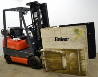 Toyota LP Forklift with Cascade Clamp Fork Lift Attachment Chicago We