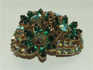 Vintage Juliana green rhinestone and Aurora Borealis flower brooch
