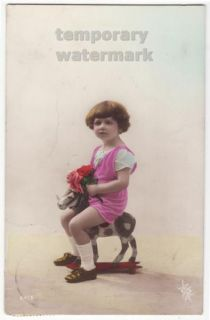 Cute Little Girl Riding Small Wooden Horse c1910s Tinted Photo