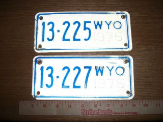 Two Wyoming Motorcycle License Plates~~1975~~225 & 227~~White & Blue
