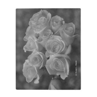 Black and white roses against spotted background display plaques