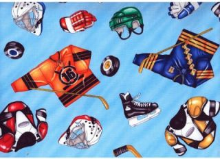 hockey equipment gear on lt blue cotton quilt fabric image shows