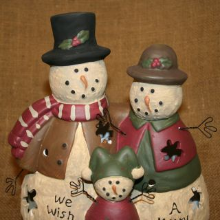 front of the snowman family it says  We Wish You A Merry Christmas