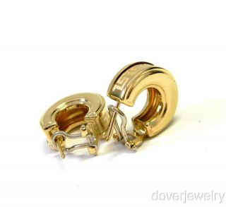 Italian estate huggie earrings are crafted in solid 14K yellow gold
