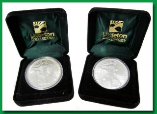 1986 & 2011 SILVER AMERICAN EAGLES 2 UNCIRCULATED COINS IN LITTLETON