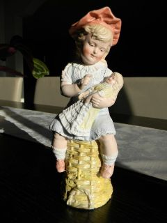 Lovely Antique Heubach Bisque Piano Baby Girl Figurine with Her Doll