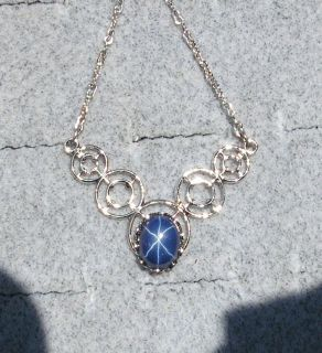 LINDE LINDY BLUE STAR SAPPHIRE CREATED RHODIUM PLATED NONPRECIOUS