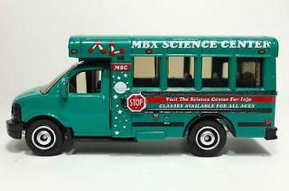 2011 Matchbox City Life GMC School Bus TEAL/MBX SCIENCE CENTER/MINT