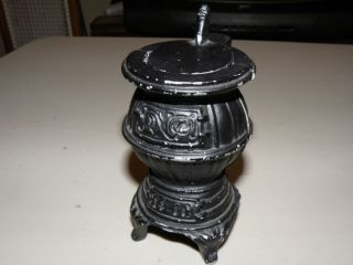 Vintage diecast miniature pot belly stove please