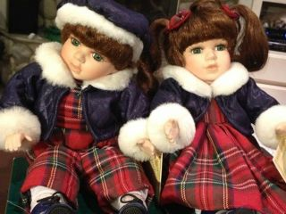 Collectors Choice WindupMusical Animated Porcelain Sitting Dolls