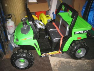Green  Power Wheels Ride on kids Arctic Cat car sits two Pick